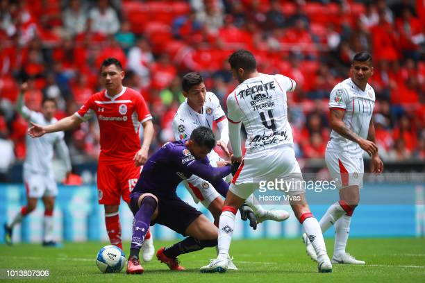 Alfredo Talavera of Toluca struggles for the ball with Jair Pereira of Chivas during the third round match between Toluca and Chivas as part of the...