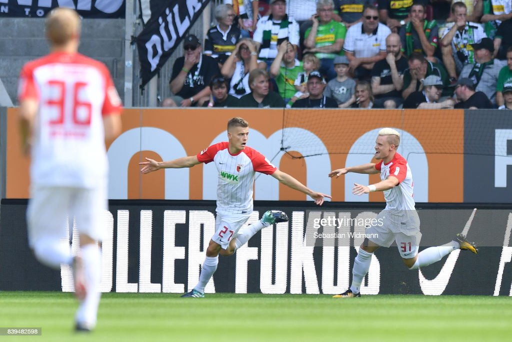 Alfreo Finnbogason of Augsburg (27) celebrates after he scored to make it 1:0 with Philipp Max of Augsburg (r) during the Bundesliga match between FC Augsburg and Borussia Moenchengladbach at WWK-Arena on August 26, 2017 in Augsburg, Germany.