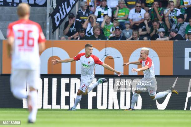 Alfreo Finnbogason of Augsburg celebrates after he scored to make it 10 with Philipp Max of Augsburg during the Bundesliga match between FC Augsburg...