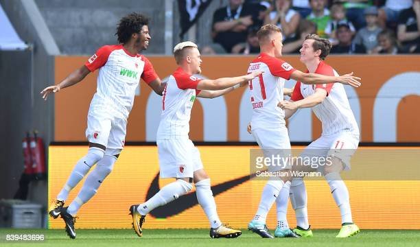 Alfreo Finnbogason of Augsburg celebrates with Michael Gregoritsch of Augsburg after he scored to make it 10 with Philipp Max of Augsburg during the...
