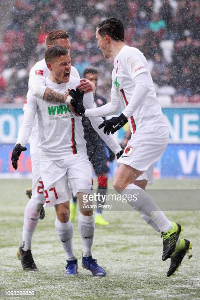 Alfreo Finnbogason of FC Augsburg celebrates scoring his teams first goal of the game from the penalty spot during the Bundesliga match between FC...