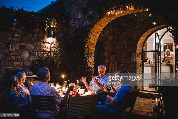 alfresco dining in the evening - wealth stock pictures, royalty-free photos & images