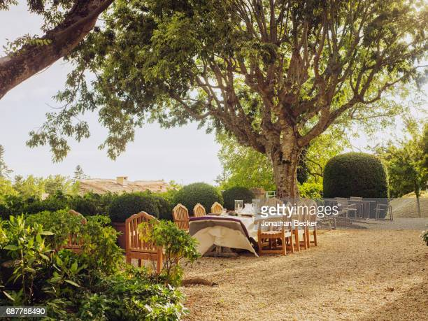 Alfresco dining on the grounds of Chateau dAutet is photographed for Vanity Fair Magazine on July 13, 2016 in Provence, France. PUBLISHED IMAGE.
