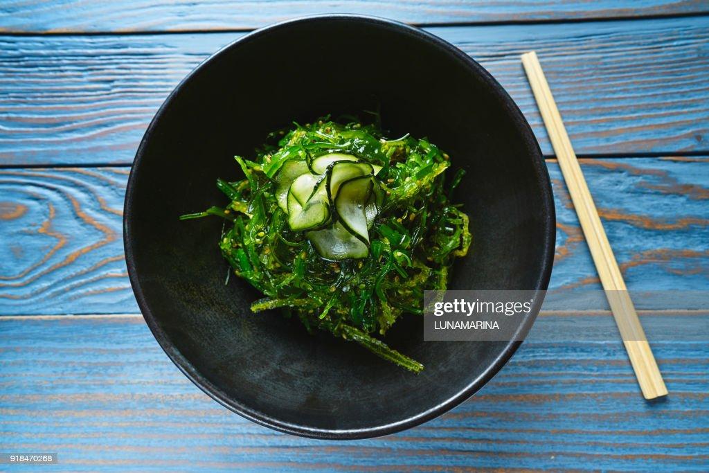 Algae salad with cucumber sesame and soya : Stock Photo
