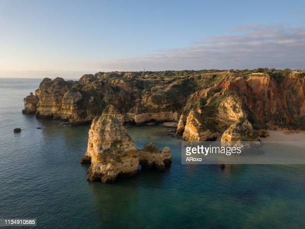 algarve aerial drone panoramic view. beautiful beach near lagos, algarve region, portugal.  seascape with cliff rocks. - ポルトガル ラゴス市 ストックフォトと画像