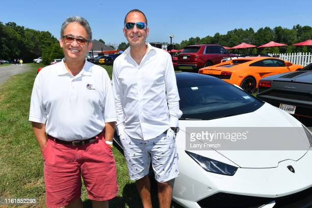 BJ Alger and Frank Rameshni seen at Grandiosity Events CigarsGuitars Charity PoloJazz charity event Powered by Logical Technology and Research at...