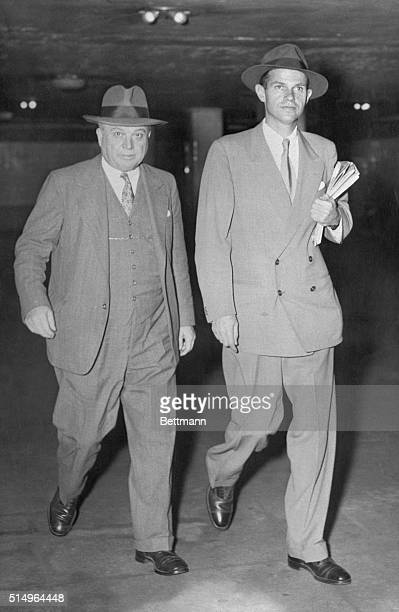 Alger Hiss former State Department employee whose previous trial ended with a hung jury is shown with his attorney Claude B Cross of Boston walking...