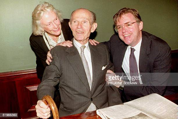 Alger Hiss the State Department lawyer accused of espionage during the McCarthy era is hugged by his wife Isabel and and son Tony 29 October 1992 at...