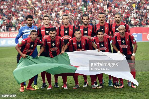 USM Alger players pose for a picture prior to the CAF Champions League semifinal football match between Algiers' USM Alger and Casablanca's Wydad AC...
