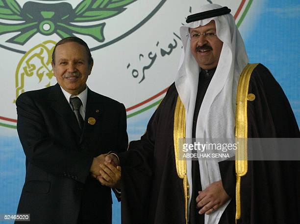 Algerian President Abdelaziz Bouteflika shakes hands with Iraq's outgoing President Gazi Yawar prior to the opening session of the 17th Arab Summit...