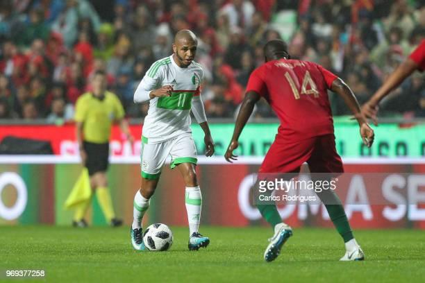 Algeria and FC Porto forward Yacine Brahimi tries to pass trough Portugal and Sporting CP midfielder William Carvalho during Portugal vs Algeria...