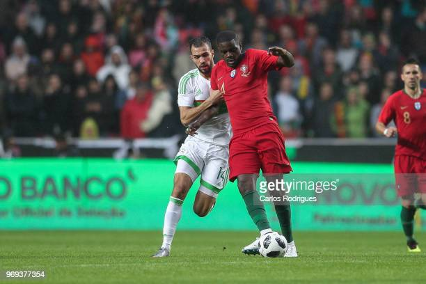 Algeria and JS Kabylie midfielder Salim Boukhenchouche vies with Portugal and Sporting CP midfielder William Carvalho for the ball possession during...