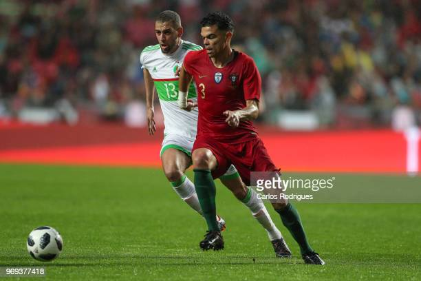 Algeria and Newcastle United forward Islam Slimani vies with Portugal and Besiktas defender Pepe for the ball possession during Portugal vs Algeria...