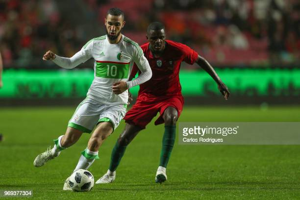 Algeria and Schalke 04 midfielder Nabil Bentaleb vies with Portugal and Sporting CP midfielder William Carvalho for the ball possession during...