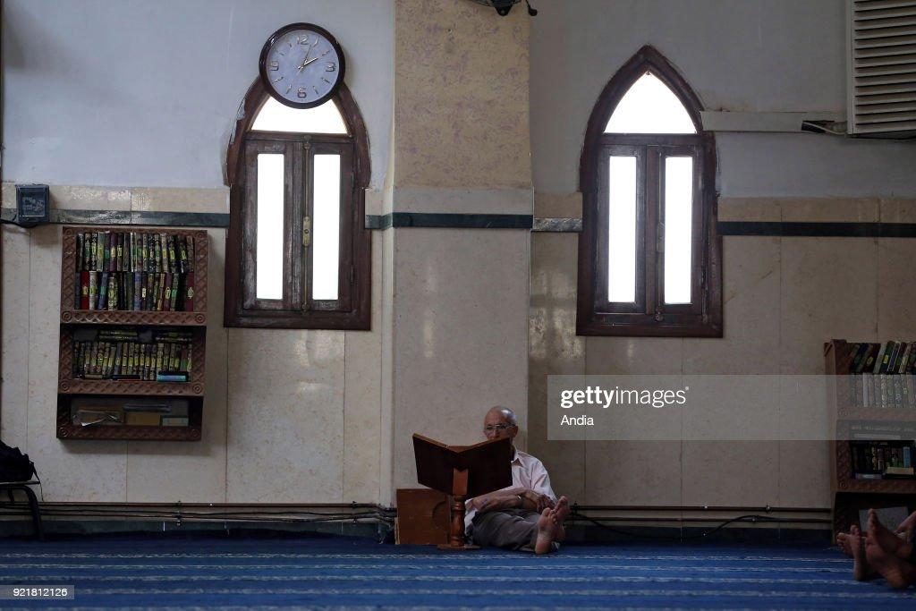 Algerian Muslim reading the Koran in a mosque in Boufarik, on the tenth day of Ramadan.