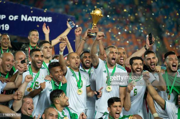 Algeria captain Riyad Mahrez lifts the trophy as his team celebrate winning the 2019 Africa Cup of Nations Final between Senegal and Algeria at at...