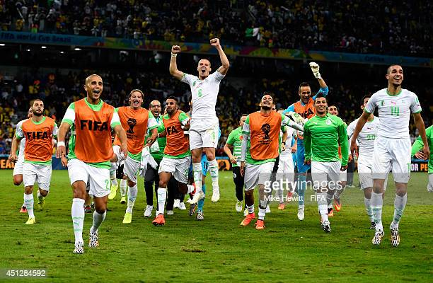 Algeria celebrate after a 11 draw during the 2014 FIFA World Cup Brazil Group H match between Algeria and Russia at Arena da Baixada on June 26 2014...