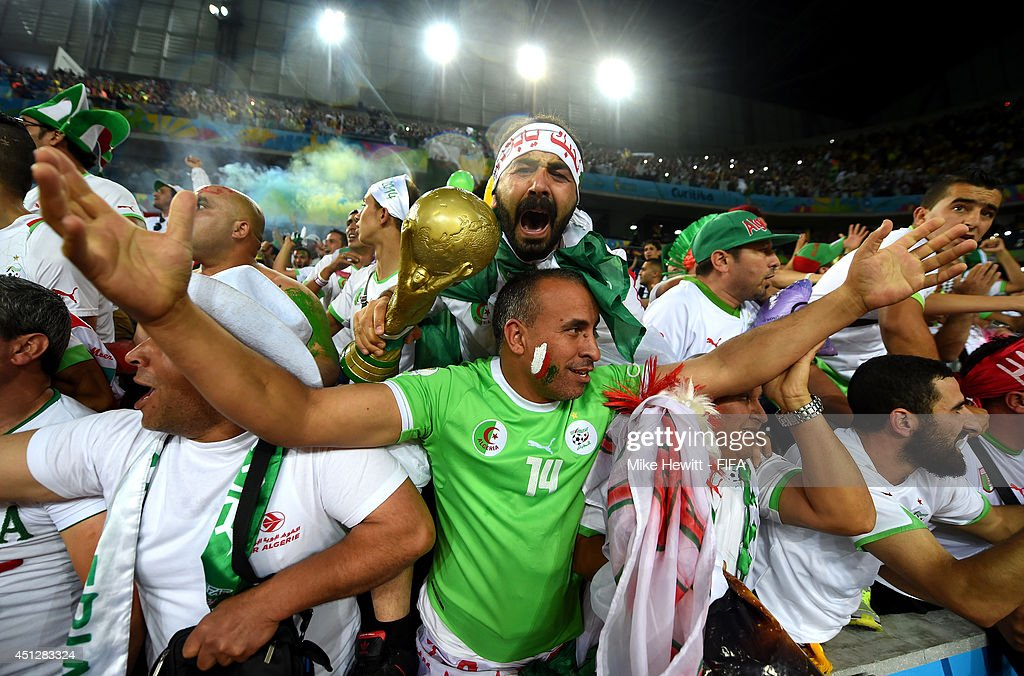 Algeria fans celebrate their team qualifying for the knock out stage after the 1-1 draw in the 2014 FIFA World Cup Brazil Group H match between Algeria and Russia at Arena da Baixada on June 26, 2014 in Curitiba, Brazil.
