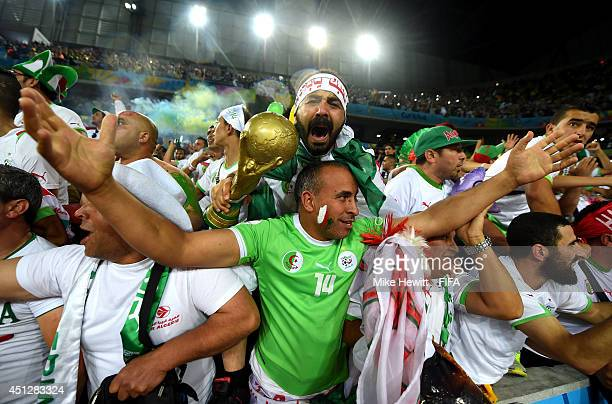 Algeria fans celebrate their team qualifying for the knock out stage after the 11 draw in the 2014 FIFA World Cup Brazil Group H match between...