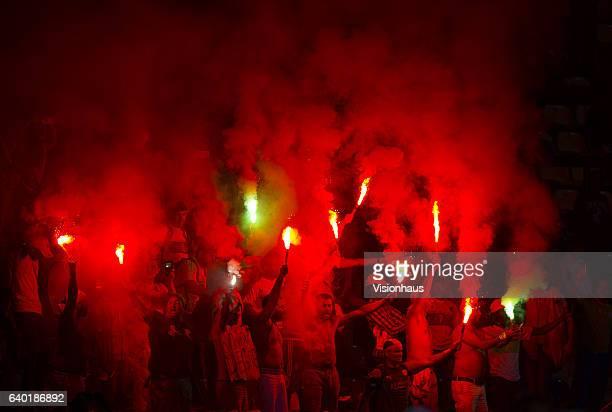 Algeria fans hold lit flares during the Group B match between Senegal and Algeria at Stade Franceville on January 23 2017 in Franceville Gabon
