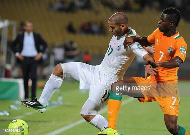 Algeria midfielder Adlene Guedioura vies for the ball with Ivory Coast Midfielder Abdul Razak during the 2013 African Cup of Nations Group D football...