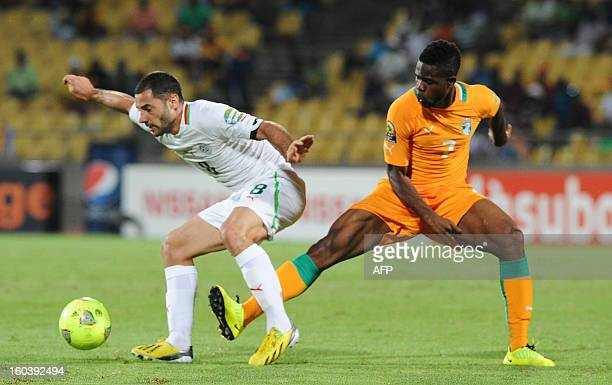 Algeria midfielder Medhi Lacen vies for the ball with Ivory Coast midfielder Abdul Razak during a 2013 African Cup of Nations Group D football match...