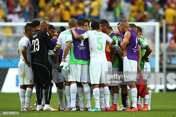 Algeria players huddle after being defeated 21 in the 2014 FIFA World Cup Brazil Group H match between Belgium and Algeria at Estadio Mineirao on...