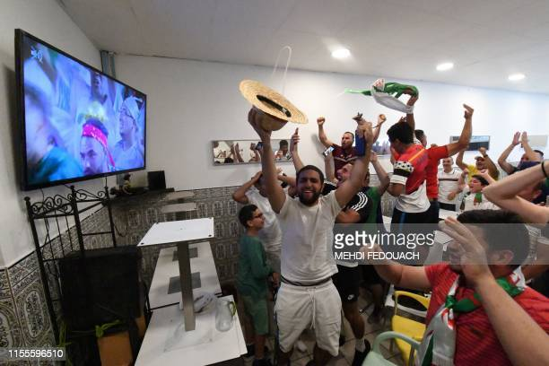 Algeria supporters celebrate after Algeria won the 2019 Africa Cup of Nations semifinal football match against Nigeria after following the match on...