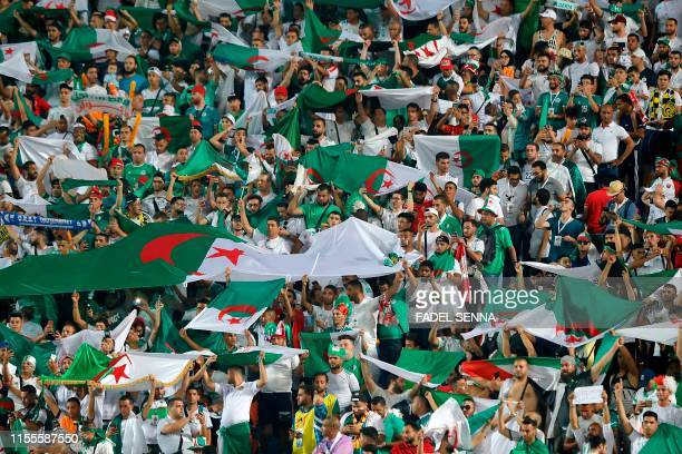 Algeria supporters cheer during the 2019 Africa Cup of Nations Semi-final football match between Algeria and Nigeria at the Cairo International...