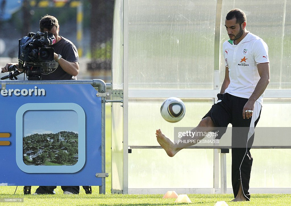 Algeria team's Mourad Meghni plays with the ball during a practice session on May 25, 2010 in the Swiss Alpine resort of Crans-Montana ahead of the FIFA World Cup 2010 finals in South Africa.