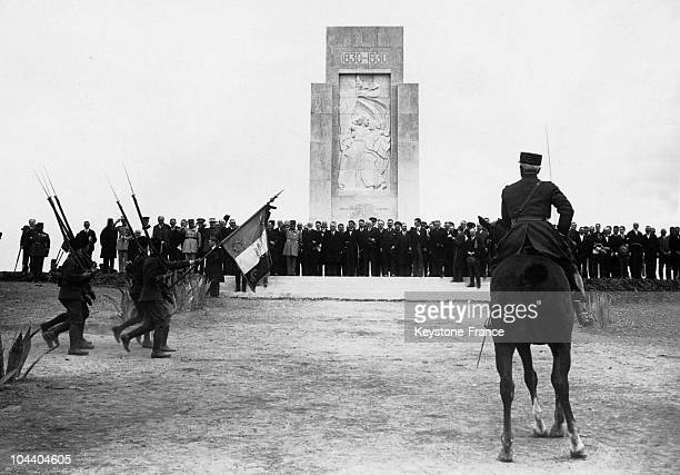 Algeria the colonial military troops march before SidiFerruch's monument in presence of President Gaston DOUMERGUE The President of the French...