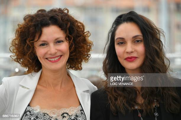 Algerian actress Nadia Kaci and Algerian actress Hania Amar pose on May 22 2017 during a photocall for the film 'Until the Birds Return' at the 70th...