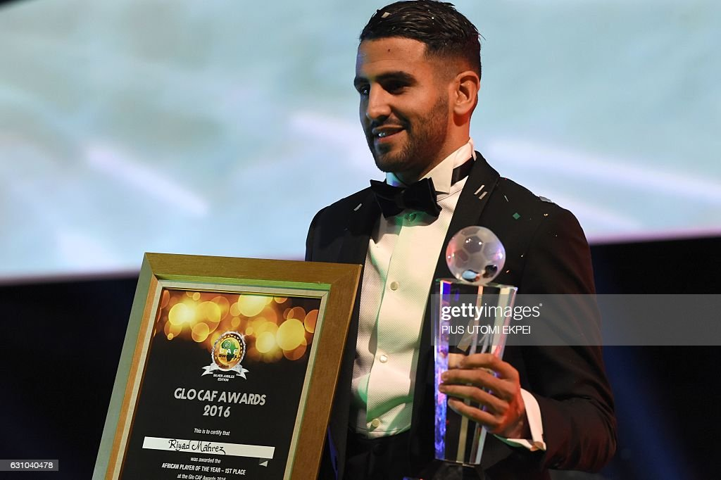 Algerian and Leicester forward Riyad Mahrez poses for a photo after being crowned African Footballer of the Year in Abuja, on January 5, 2017. Algerian and Leicester striker Riyad Mahrez has been crowned the CAF African best Footballer for 2016 and beating former best player and Gabonese forward Pierre-Emerick Aubameyang and Sehegalese striker Sadio Mane, for the continent's most prestigious individual award. / AFP / PIUS