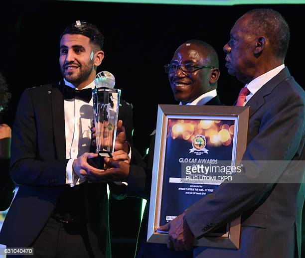 Algerian and Leicester forward Riyad Mahrez receives trophy from Nigeria's sports minister Solomon Dalung and CAF President Issa Hayatou after being...