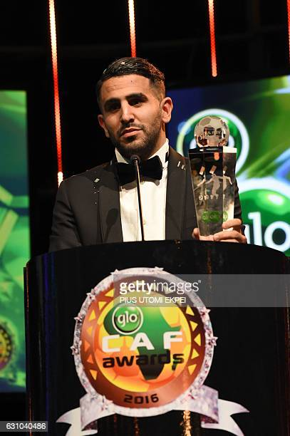Algerian and Leicester forward Riyad Mahrez speaks while holding trophy after being crowned African Footballer of the Year in Abuja on January 5 2017...
