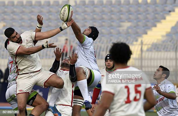 Algerian and Tunisian players fight for the ball during their friendly rugby match Alegria's first international rugby match on home soil on December...