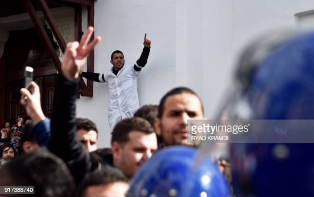 Algerian anti riot police face doctors and dentists who are completing their residency stage of their studies during a sitin outside La Grande Poste...