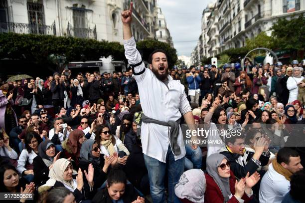 Algerian anti riot police surround doctors and dentists who are completing their residency stage of their studies during a sitin outside La Grande...