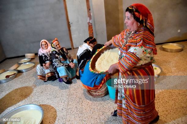 Algerian Berber women prepare couscous as they mark the Yennayer New Year in the village of Ait elKecem south of TiziOuzou east of the capital...