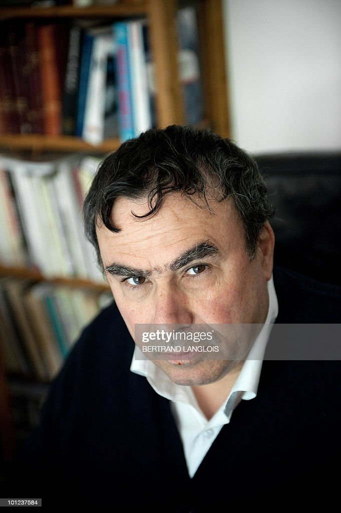 Algerian born historian and writer Benjamin Stora poses on May 6, 2010 at his home in Asnieres-sur-Seine, a Paris suburb. Stora is one of 12 intellectuals who published a text on yesterday replying to accusations of colonial history 'falsifications' in the Franco-Algerian film 'Hors-la-loi', by Rachid Bouchareb to be presented at the Cannes Film Festival this month.