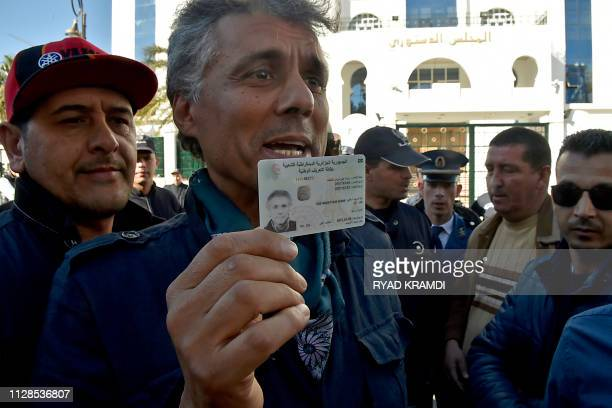 Algerian businessman and political activist Rachid Nekkaz shows his ID card as he arrives at the constitutional council to submit his candidacy for...