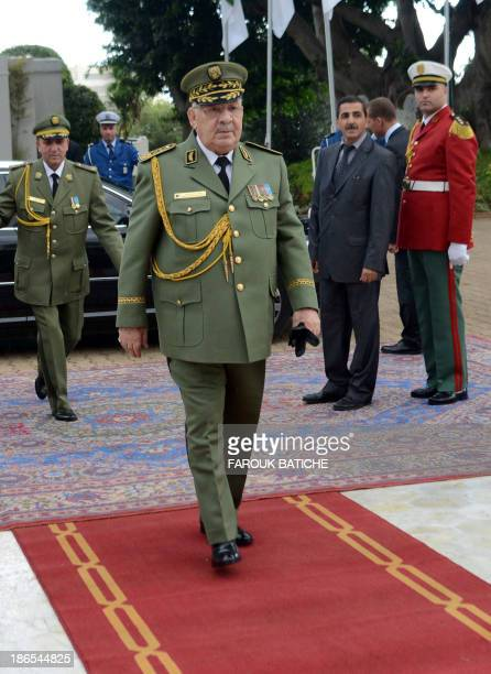 Algerian chief of staff General Ahmed Gaid Salah arrives at the People's Palace in the capital Algiers on November 1 2013 as he attends a ceremony...