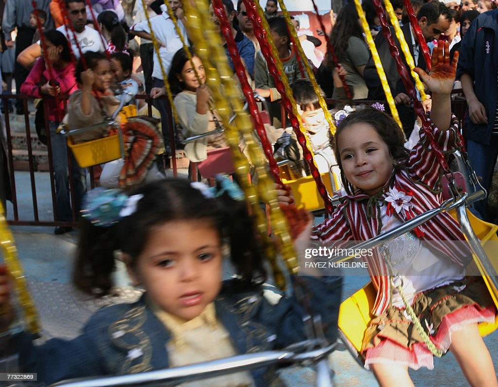 Algerian children enjoy a ride at a park in Algiers city, 14 October 2007, on the occaision of Eid-al-Fitr. The three-day festival, which begins after the sighting of a new crescent moon, marks the end of the Muslim fasting month of Ramadan, during which devout Muslims abstain from food, drink, smoking and sex from dawn to dusk..