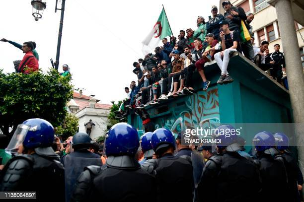 Algerian demonstrators are confronted by riot police during an anti government demonstration in the capital Algiers on April 19 2019 Protesters in...