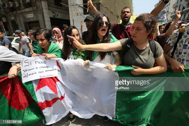 Algerian demonstrators carry a placard calling for the release of detainees as they take part in a protest in the capital Algiers on July 2, 2019. -...