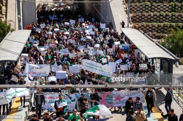 Algerian demonstrators gather during an antigovernment protest outside the Oran province government headquarters in its capital and northern coastal...