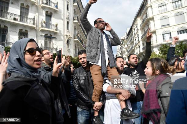 Algerian doctors and dentists who are completing their residency stage of their studies chant during a sitin outside La Grande Poste in the capital...