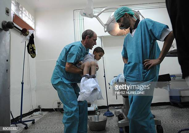 Algerian doctors prepare a boy to be circumcised during a mass circumcision at a local hospital September 27 2008 in Algiers The Muslim religion...