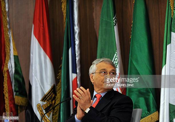Algerian Energy and Mines minister Chakib Khelil applauds an unseen speaker during the opening ceremony of the of the 'Gaz Exporting Meeting Forum'...