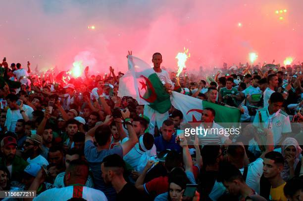 Algerian fans celebrate after their team won the 2019 Africa Cup of Nations Final football match between Senegal and Algeria, in Algiers on July 19,...